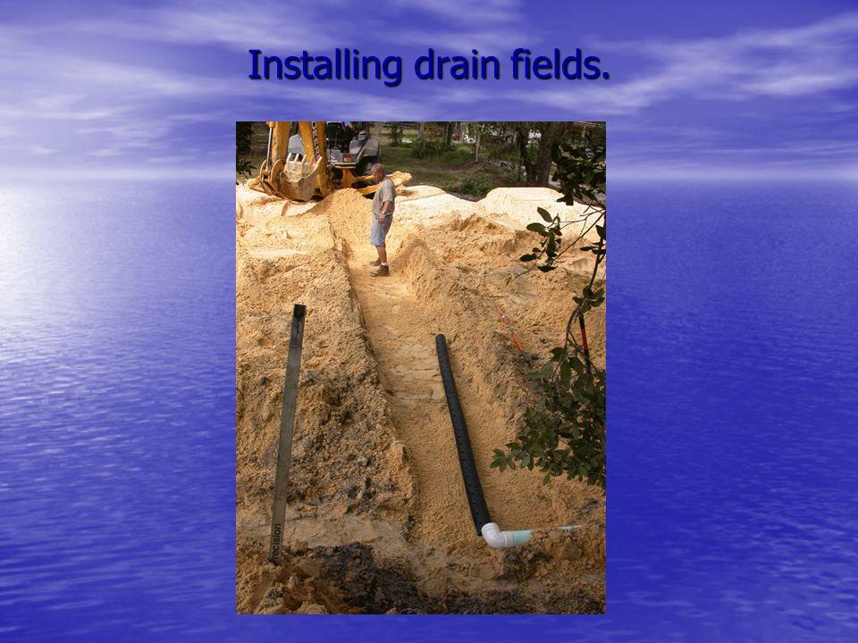 Installing drain fields.
