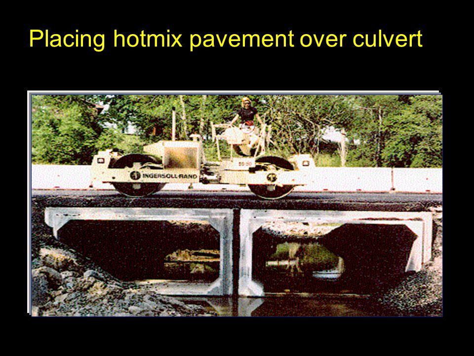 Placing hotmix pavement over culvert