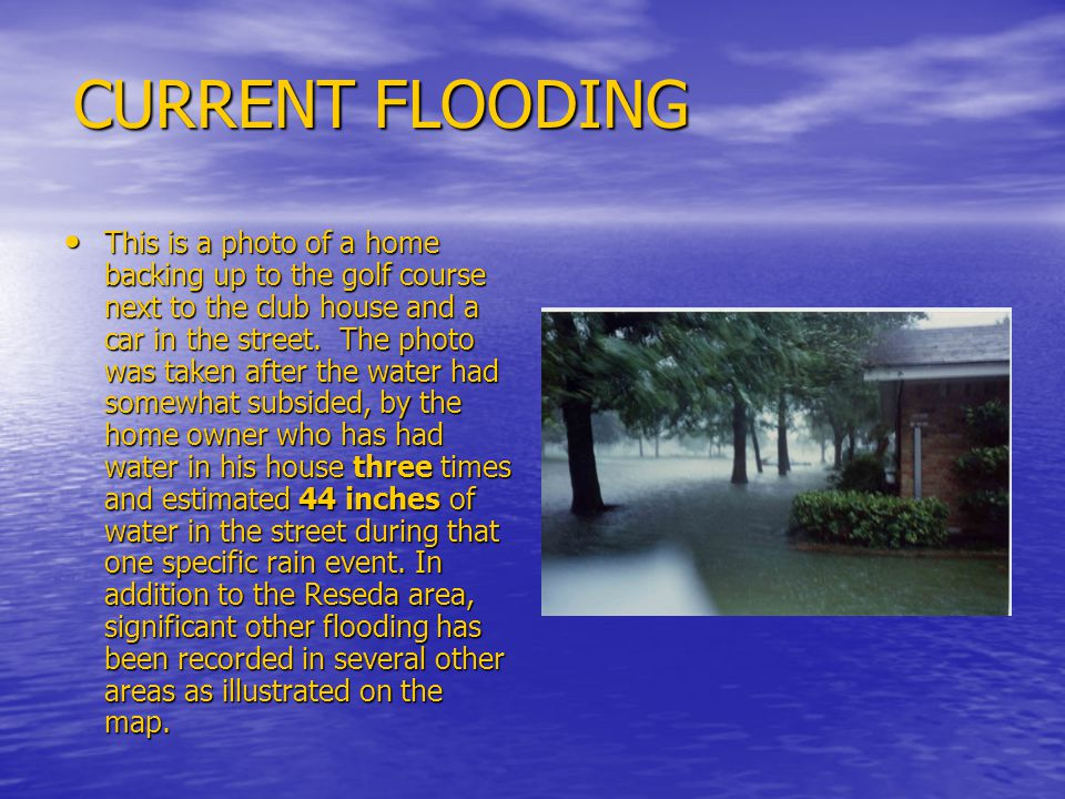 CURRENT FLOODING This is a photo of a home backing up to the golf course next to the club house and a car in the street.