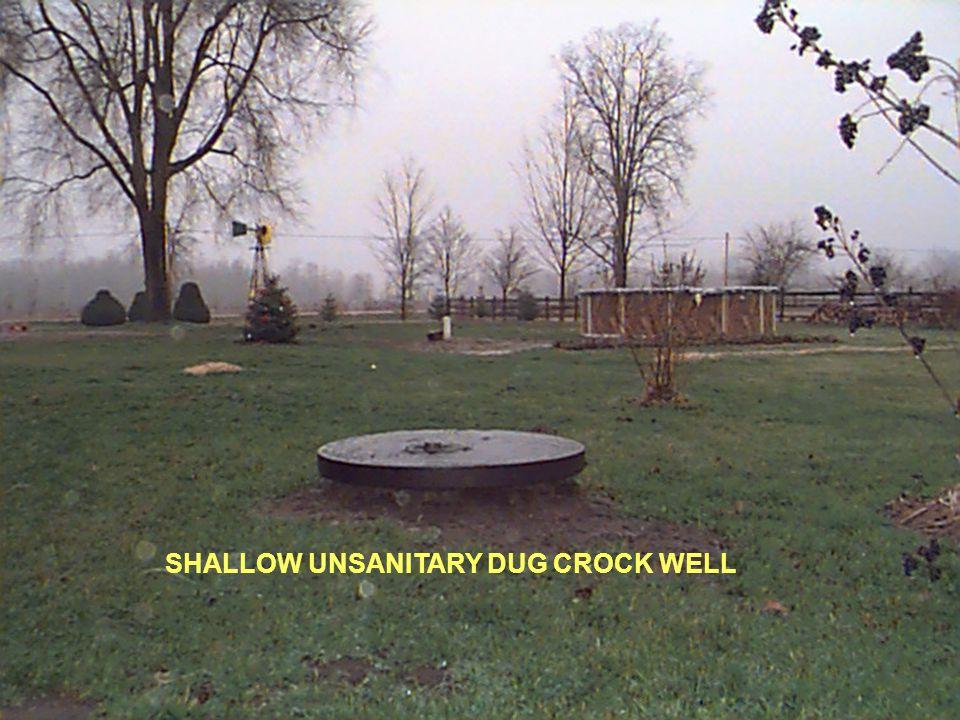 SHALLOW UNSANITARY DUG CROCK WELL
