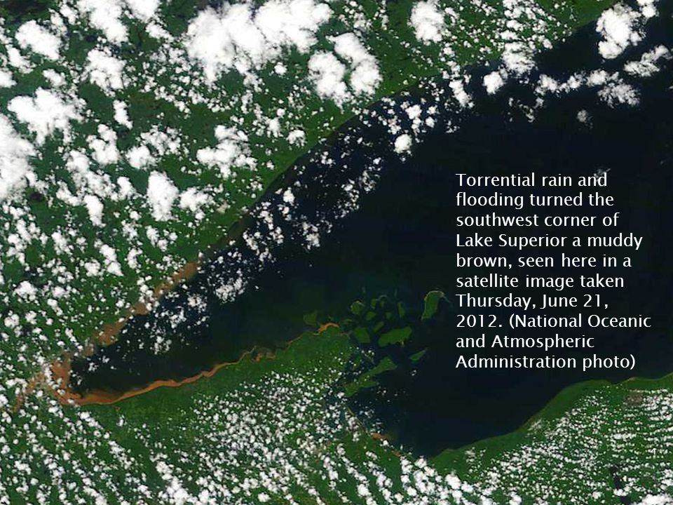 Torrential rain and flooding turned the southwest corner of Lake Superior a muddy brown, seen here in a satellite image taken Thursday, June 21, 2012.