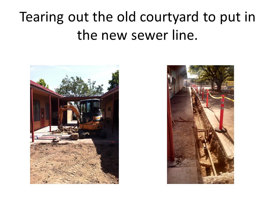 Tearing out the old courtyard to put in the new sewer line.