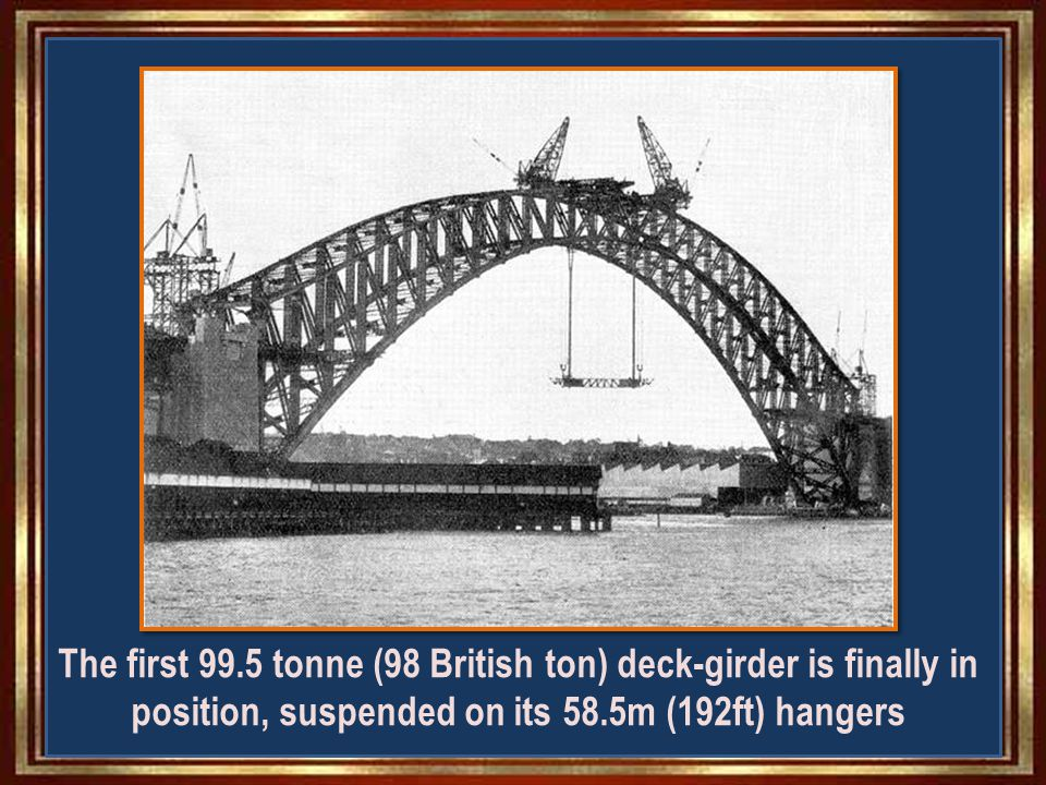 The first of 21 girders, weighing 99.5 tonnes (98 British tons), is lifted the 48.77m (160ft) above the water to meet the two hangers it will be mated with