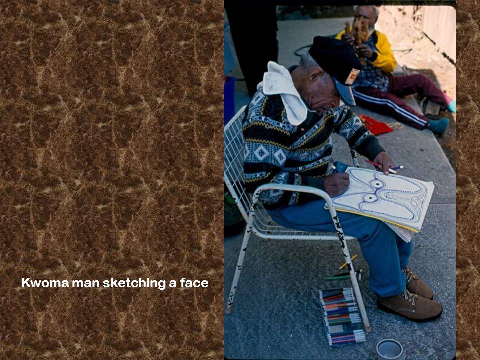 Kwoma man sketching a face