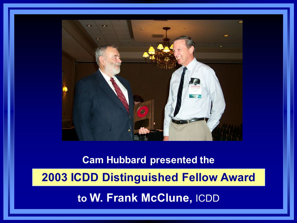 Cam Hubbard presented the to W. Frank McClune, ICDD 2003 ICDD Distinguished Fellow Award