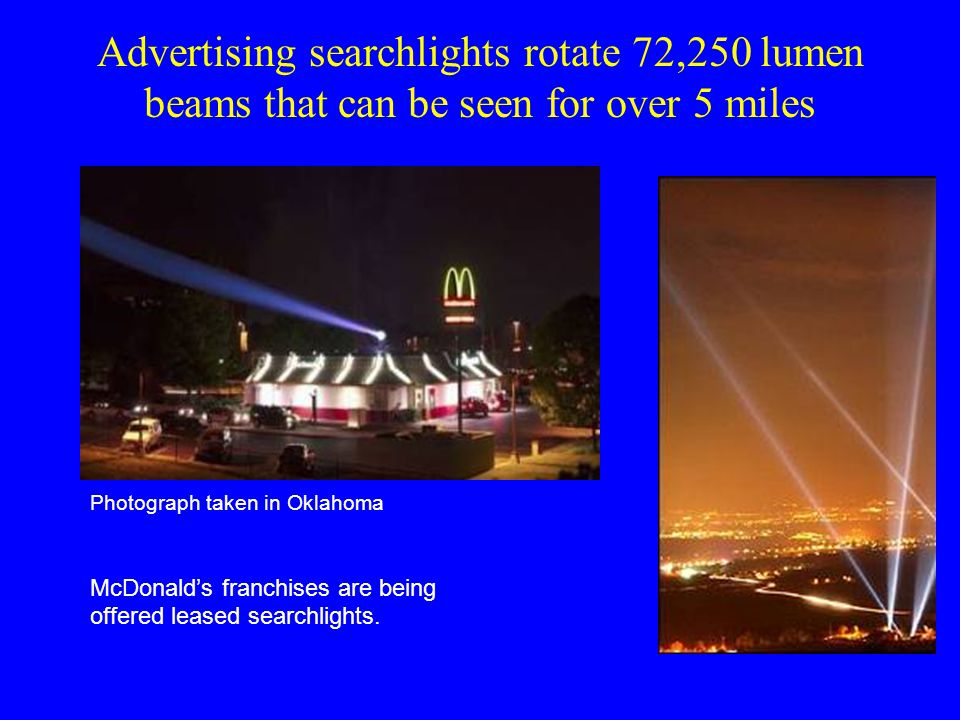 Advertising searchlights rotate 72,250 lumen beams that can be seen for over 5 miles Photograph taken in Oklahoma McDonald's franchises are being offered leased searchlights.