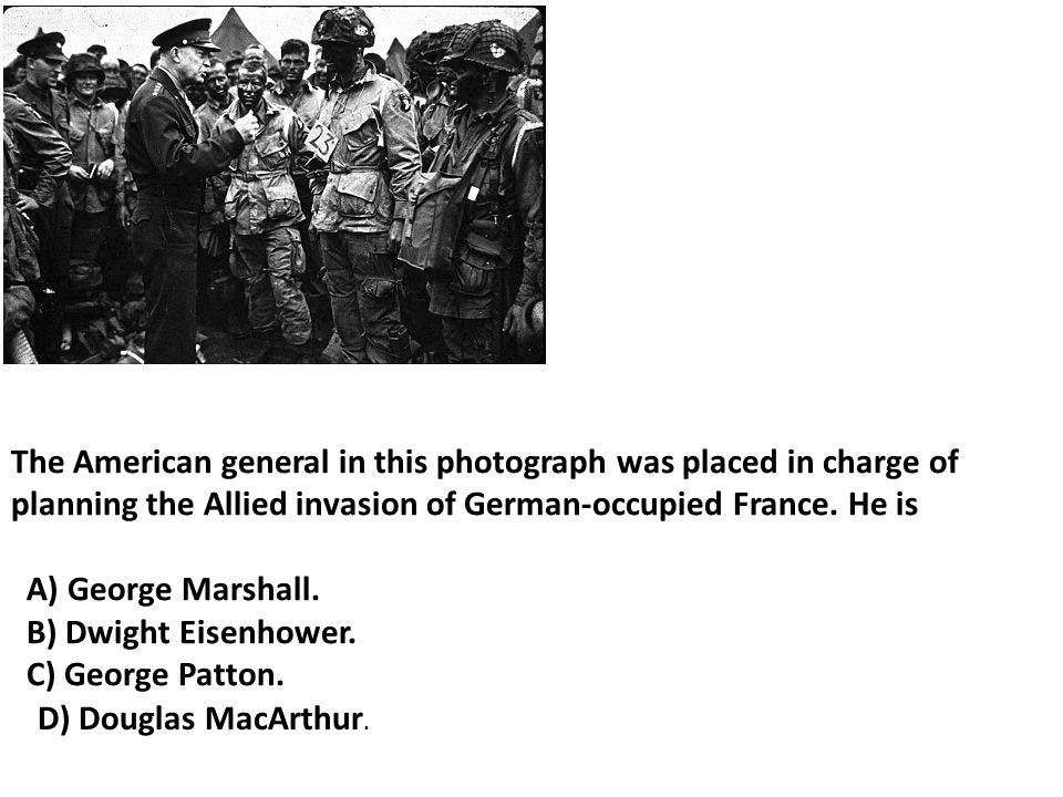 The American general in this photograph was placed in charge of planning the Allied invasion of German-occupied France.