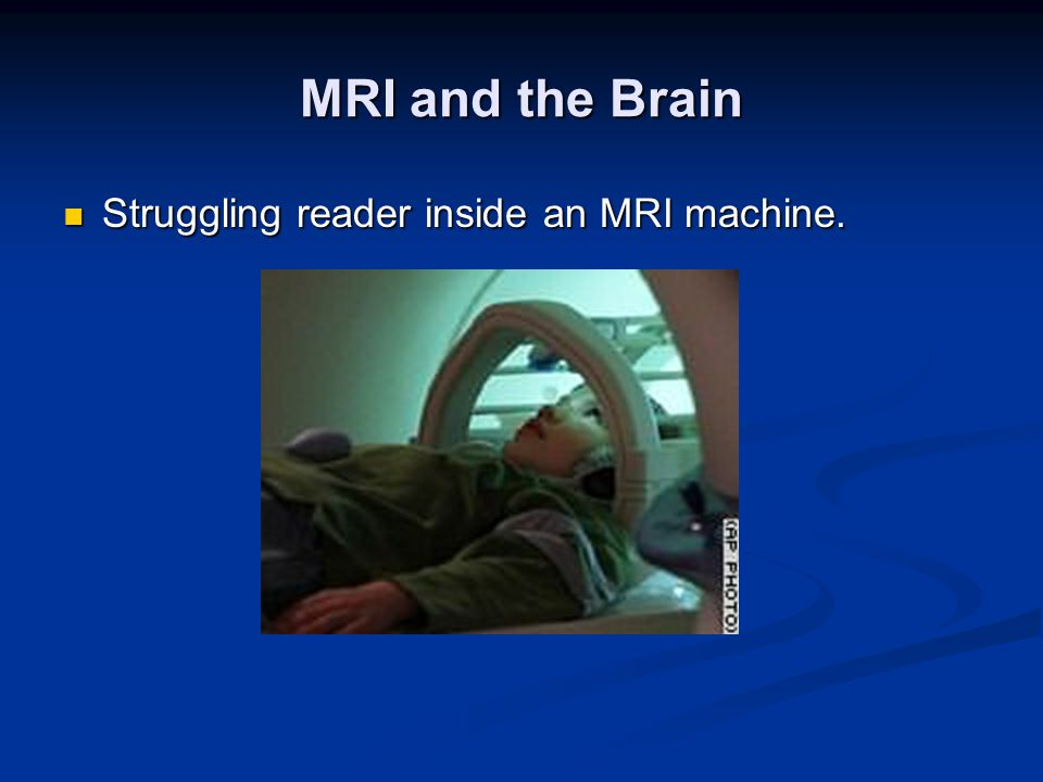 MRI and the Brain Struggling reader inside an MRI machine. Struggling reader inside an MRI machine.