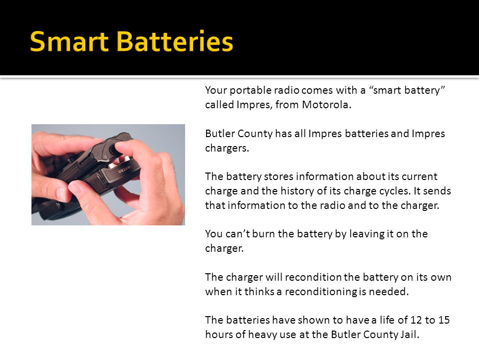 To install the battery: 1.Turn the radio off 2.Hold the radio with the back facing upward.