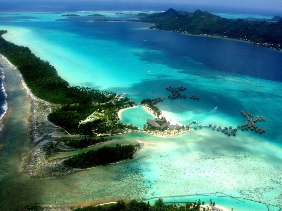 Commune of Bora Bora The commune of Bora-Bora is made up of the island of Bora Bora proper with its surrounding islets emerging from the coral reef, 29.3 km² (11.3 sq mi) in total, and of the atoll of Tupai (11 km2/4.2 sq mi), located 20 kilometres (12 mi) north of Bora Bora.