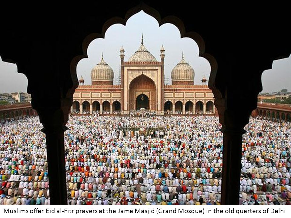 Muslims offer Eid al-Fitr prayers at the Jama Masjid (Grand Mosque) in the old quarters of Delhi