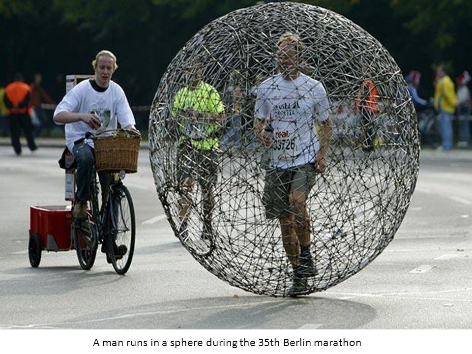 A man runs in a sphere during the 35th Berlin marathon