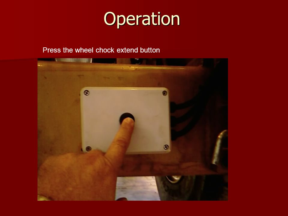 Operation Wheel chock holder will extend down Remove wheel chocks and place at the front and rear of Position 1 wheel
