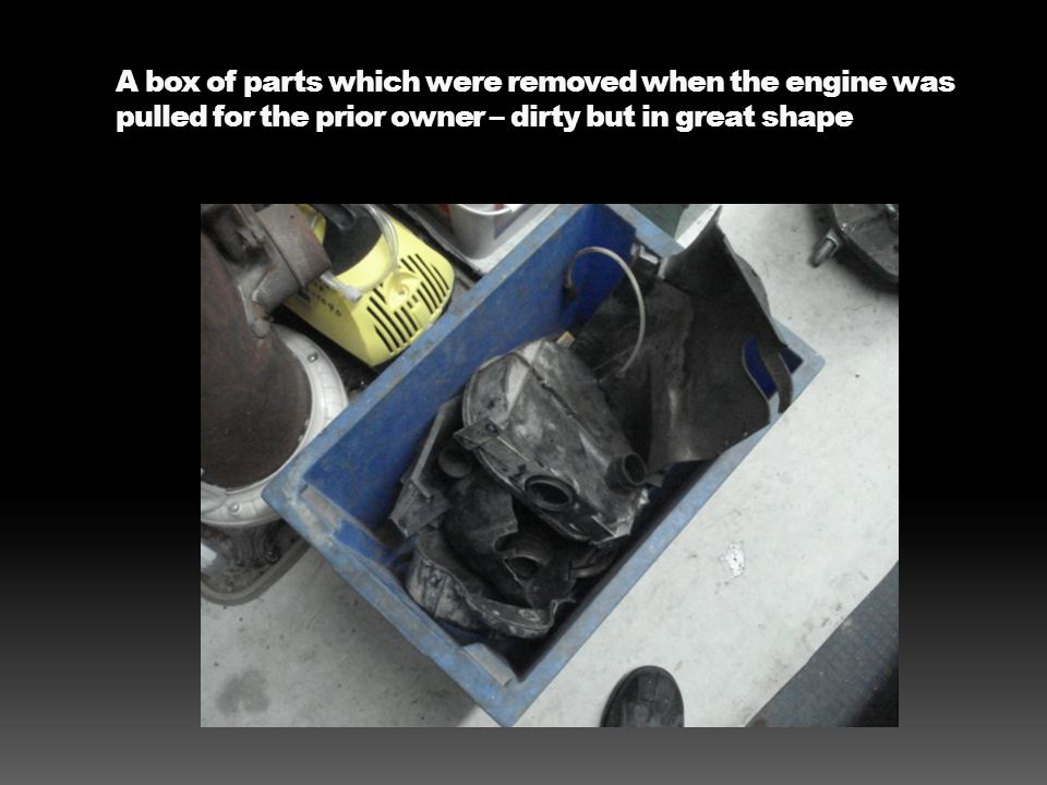 A box of parts which were removed when the engine was pulled for the prior owner – dirty but in great shape