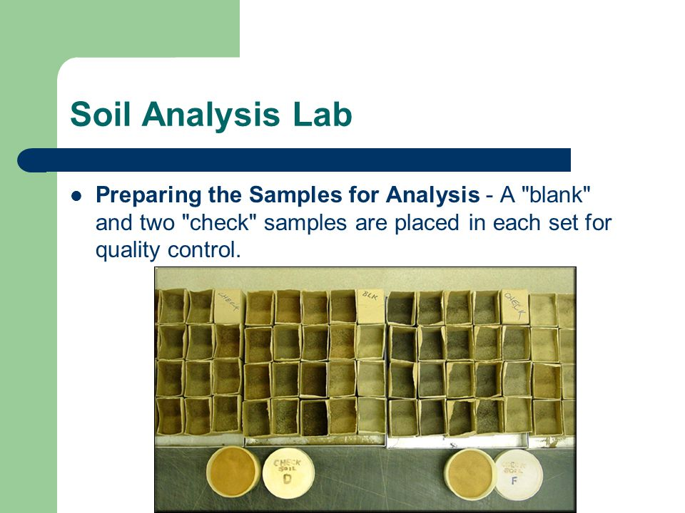 Soil Analysis Lab Preparing the Samples for Analysis - A blank and two check samples are placed in each set for quality control.