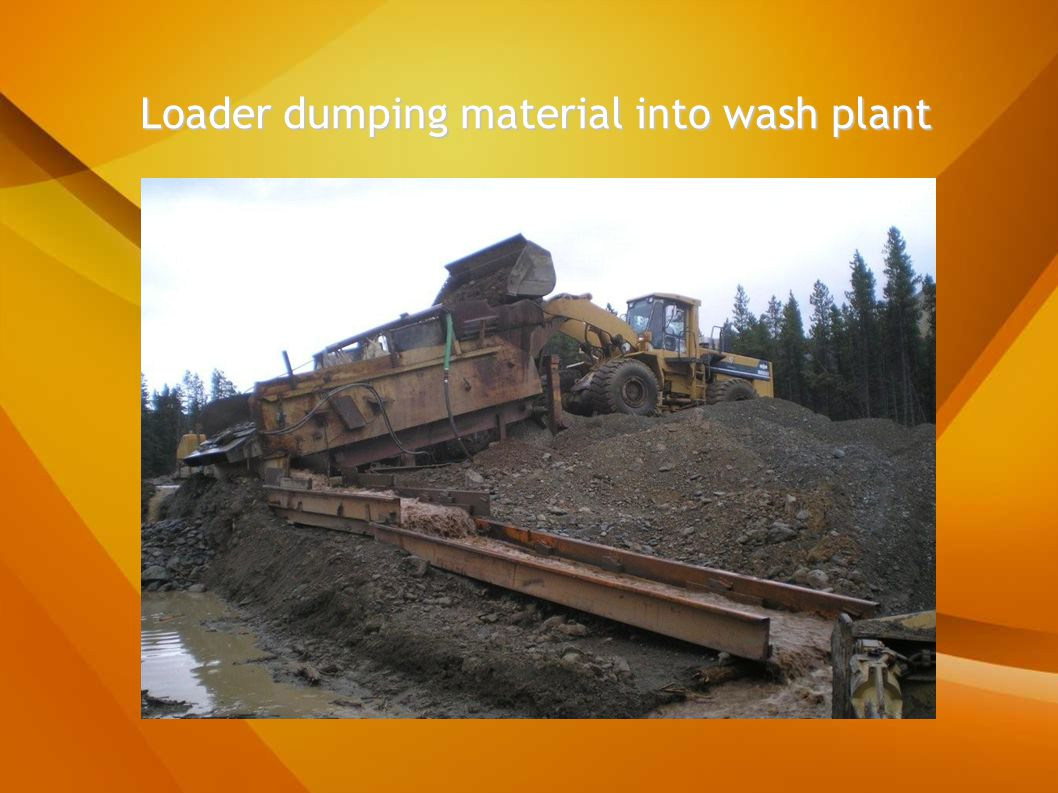 Loader dumping material into wash plant Loader dumping material into wash plant