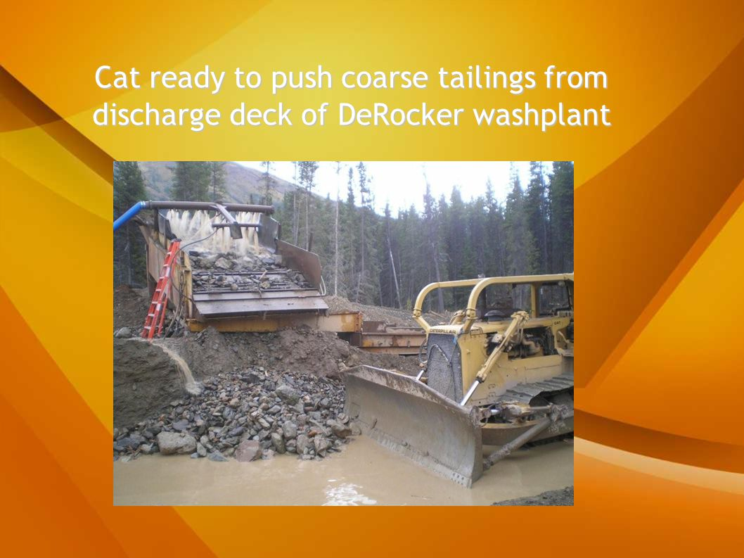 Cat ready to push coarse tailings from discharge deck of DeRocker washplant