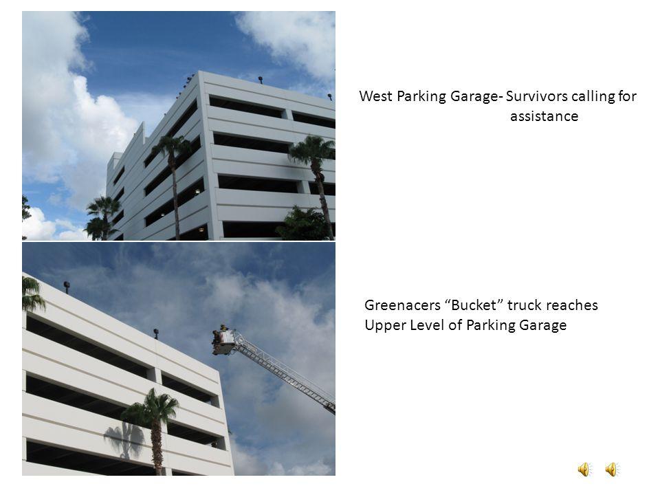 West Parking Garage- Survivors calling for assistance Greenacers Bucket truck reaches Upper Level of Parking Garage