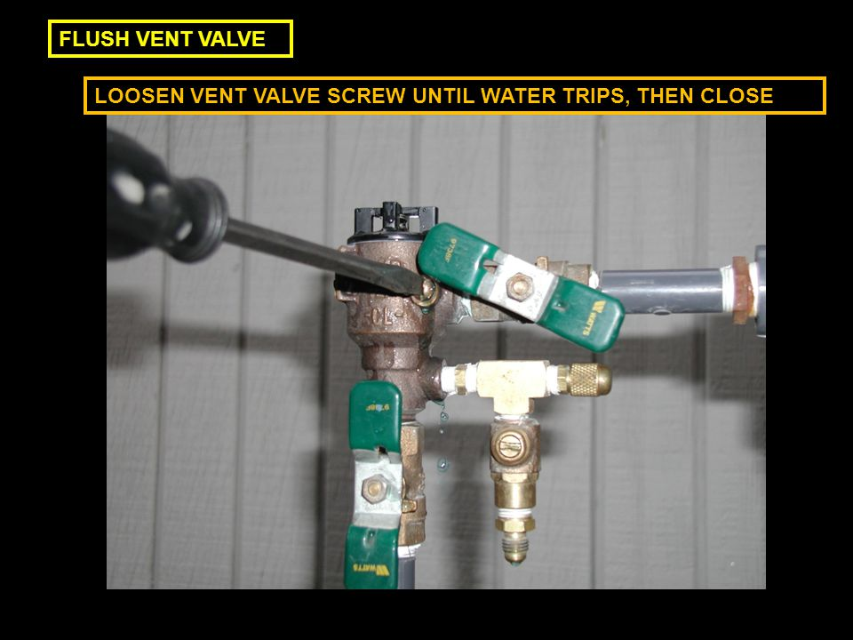 FLUSH VENT VALVE LOOSEN VENT VALVE SCREW UNTIL WATER TRIPS, THEN CLOSE