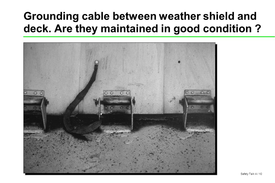 Safety Talk 4 / 10 Grounding cable between weather shield and deck.