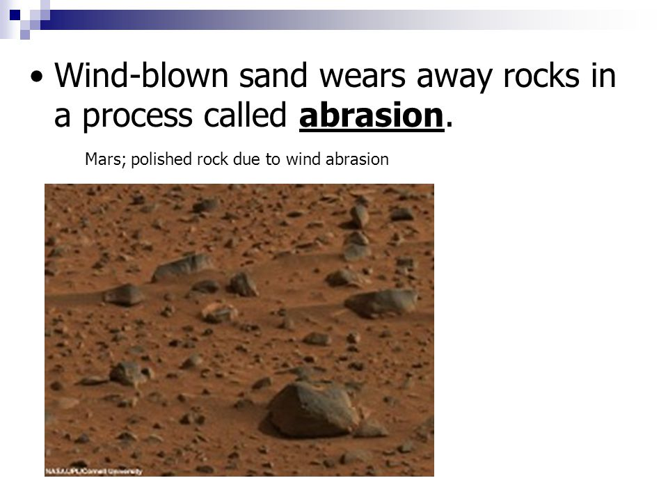 Wind-blown sand wears away rocks in a process called abrasion. Mars; polished rock due to wind abrasion