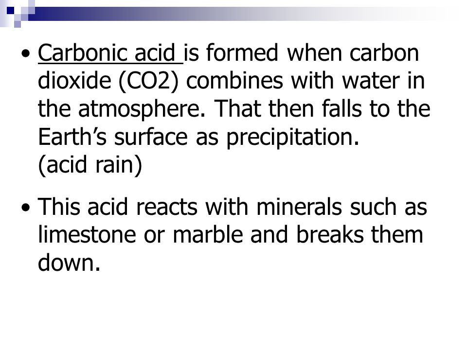 Carbonic acid is formed when carbon dioxide (CO2) combines with water in the atmosphere.