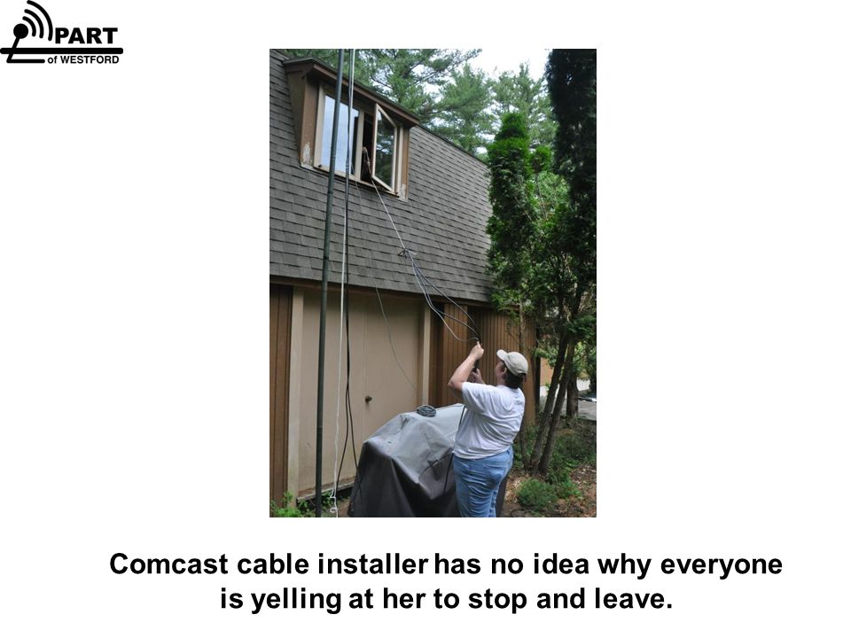Comcast cable installer has no idea why everyone is yelling at her to stop and leave.