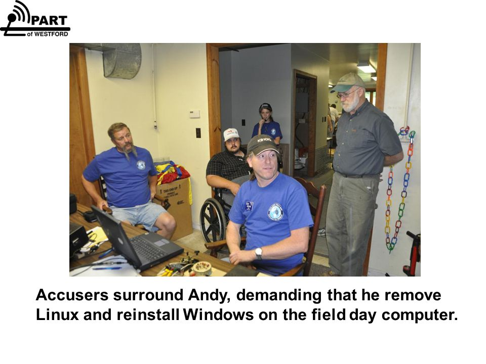 Accusers surround Andy, demanding that he remove Linux and reinstall Windows on the field day computer.