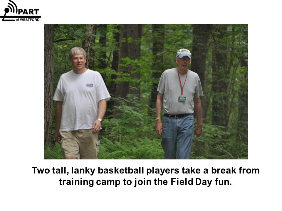 Two tall, lanky basketball players take a break from training camp to join the Field Day fun.