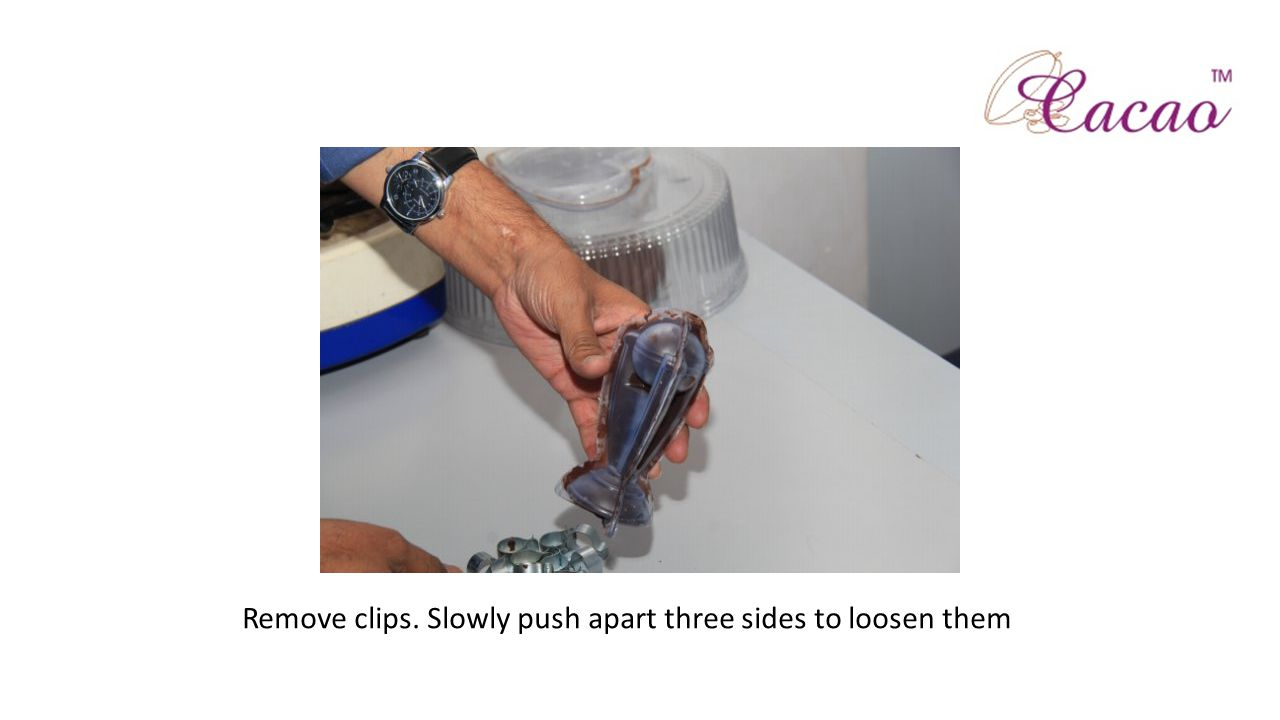 Remove clips. Slowly push apart three sides to loosen them