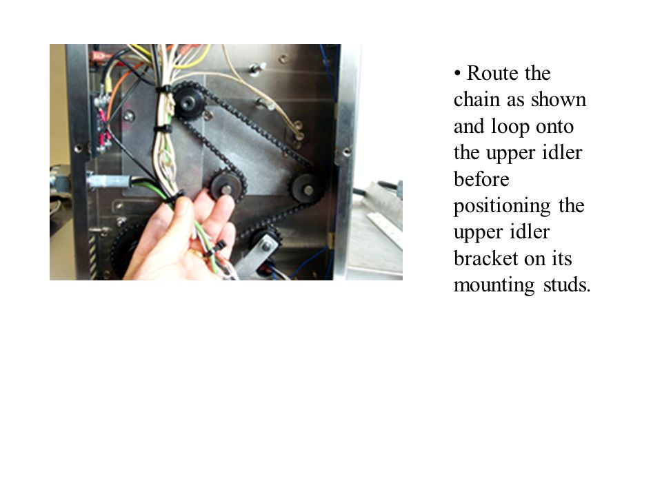 Route the chain as shown and loop onto the upper idler before positioning the upper idler bracket on its mounting studs.