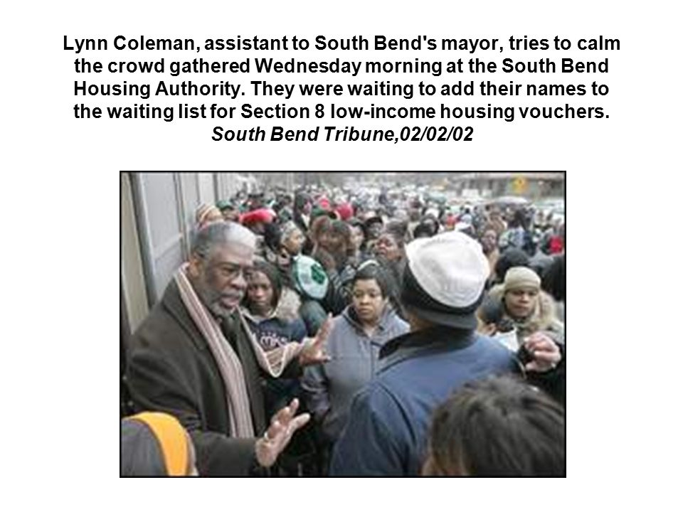 Lynn Coleman, assistant to South Bend s mayor, tries to calm the crowd gathered Wednesday morning at the South Bend Housing Authority.