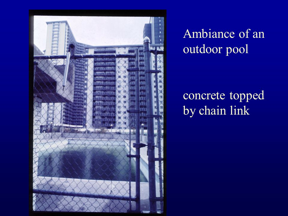 Ambiance of an outdoor pool concrete topped by chain link