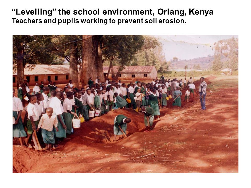 Levelling the school environment, Oriang, Kenya Teachers and pupils working to prevent soil erosion.