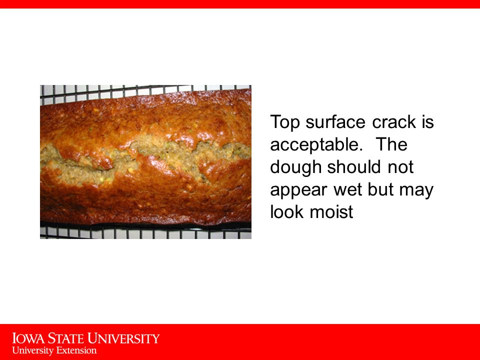 Top surface crack is acceptable. The dough should not appear wet but may look moist