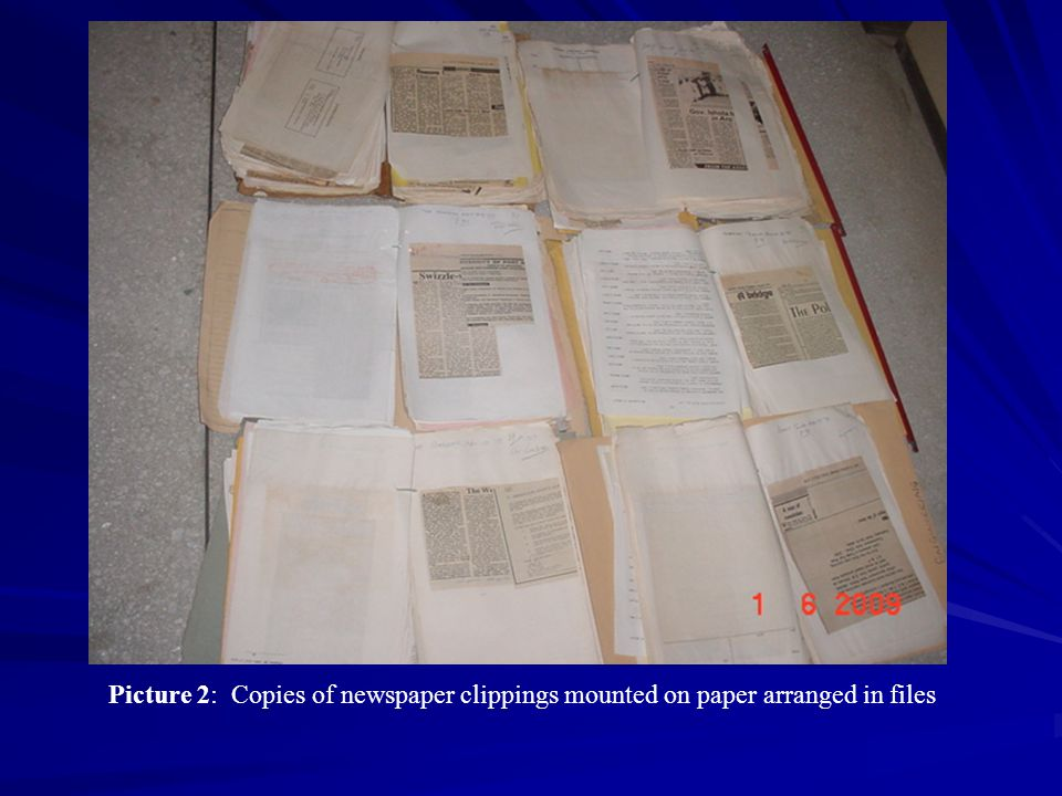 Picture 2: Copies of newspaper clippings mounted on paper arranged in files