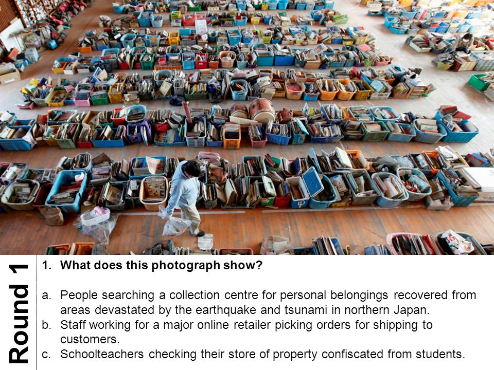 1.What does this photograph show? a.People searching a collection centre for personal belongings recovered from areas devastated by the earthquake and
