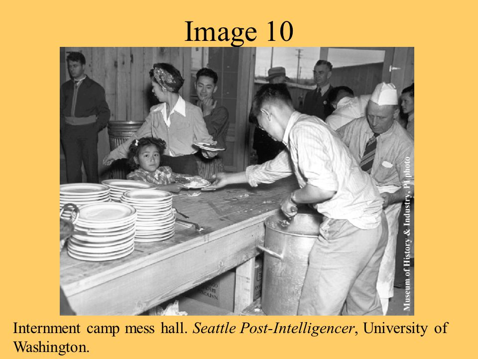 Image 9 An American Soldier on guard duty at an internment camp holds a Japanese American child.