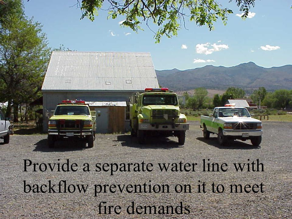Provide a separate water line with backflow prevention on it to meet fire demands