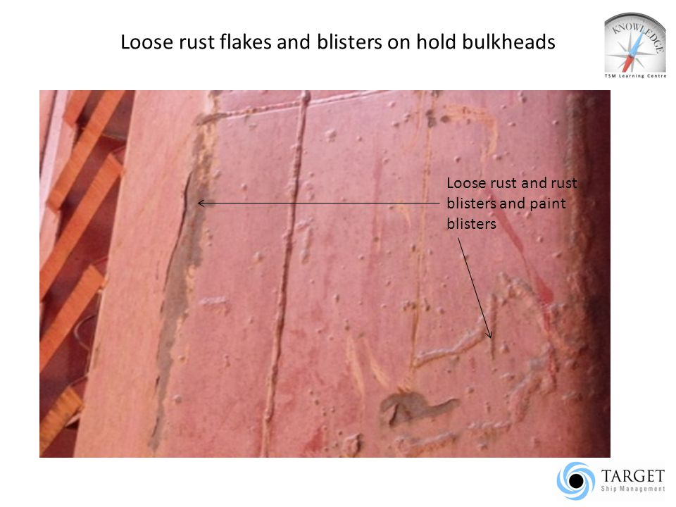 Loose rust flakes and blisters on hold bulkheads Loose rust and rust blisters and paint blisters