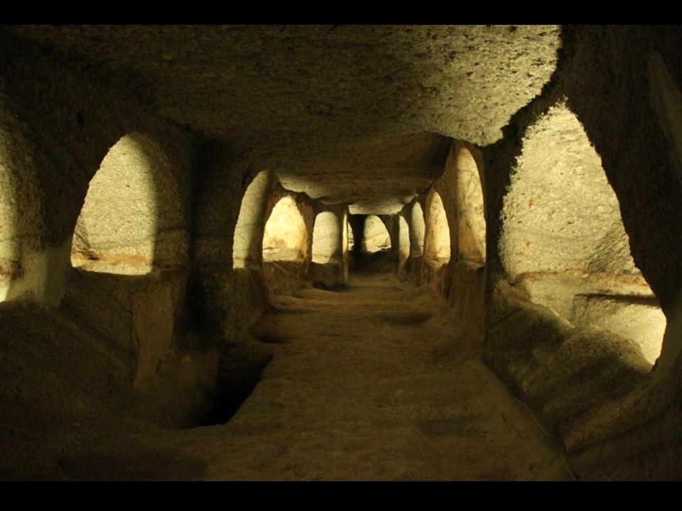 Catacombs In the vicinity of the Ancient City, SSW of the village of Tripiti, 150 metres above sea level, on a comparatively steep hillside, are the Catacombs of Milos.