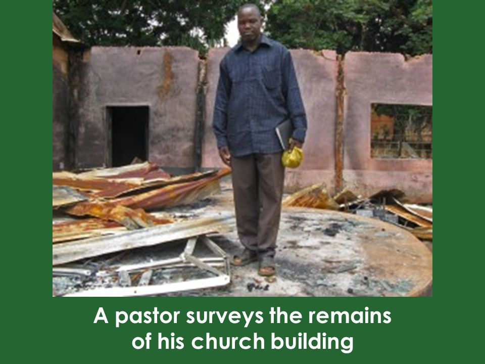 A pastor surveys the remains of his church building