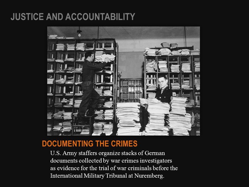 U.S. Army staffers organize stacks of German documents collected by war crimes investigators as evidence for the trial of war criminals before the Int