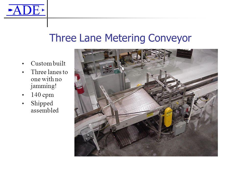 Three Lane Metering Conveyor Custom built Three lanes to one with no jamming.