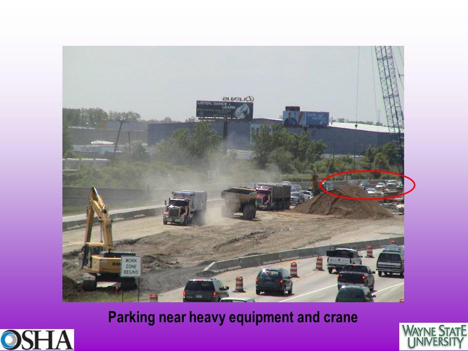 Parking near heavy equipment and crane