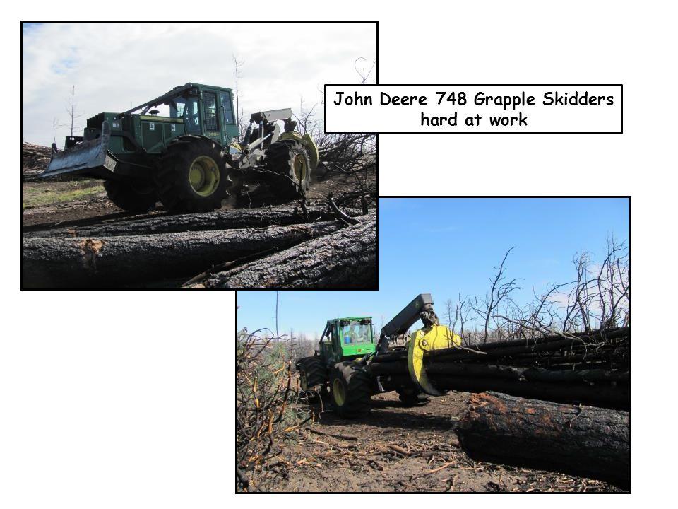 John Deere 748 Grapple Skidders hard at work
