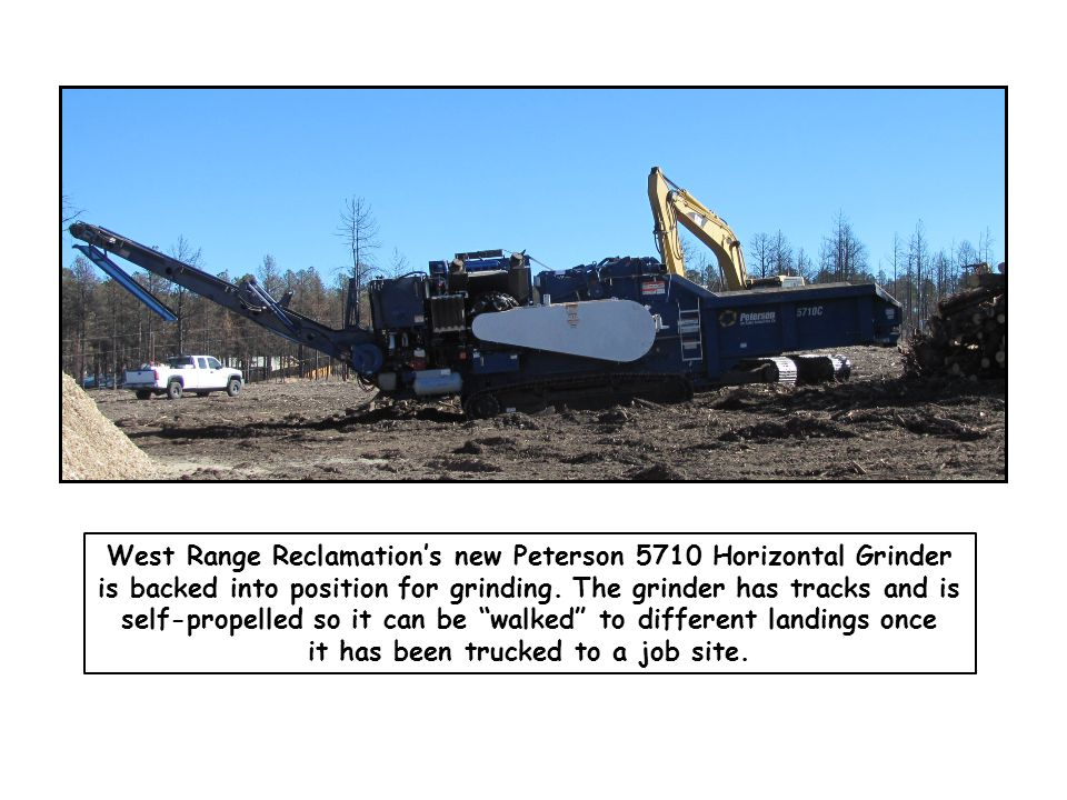 West Range Reclamation's new Peterson 5710 Horizontal Grinder is backed into position for grinding. The grinder has tracks and is self-propelled so it