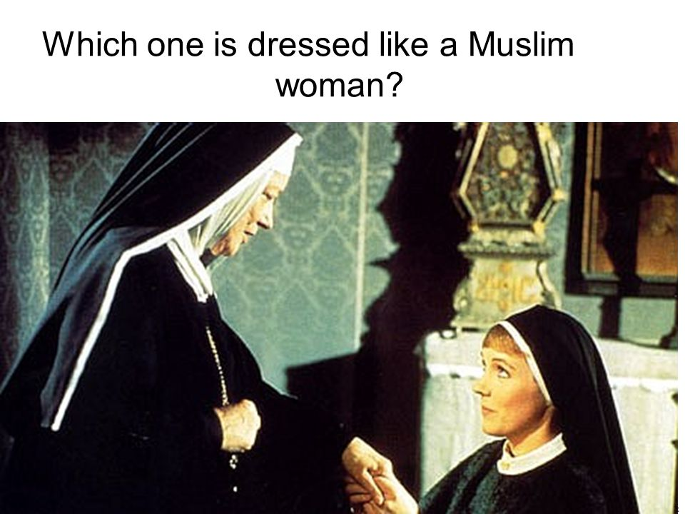 Which one is dressed like a Muslim woman? AJQ