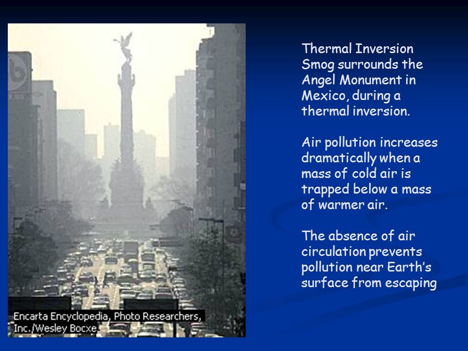 Thermal Inversion Smog surrounds the Angel Monument in Mexico, during a thermal inversion. Air pollution increases dramatically when a mass of cold ai