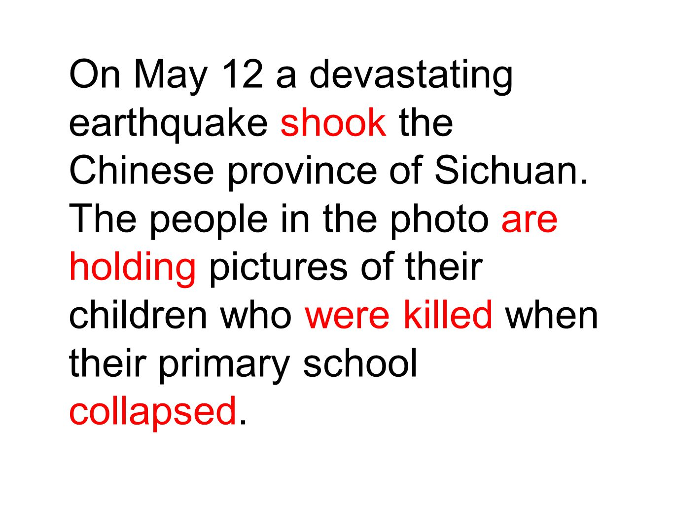 On May 12 a devastating earthquake shook the Chinese province of Sichuan. The people in the photo are holding pictures of their children who were kill